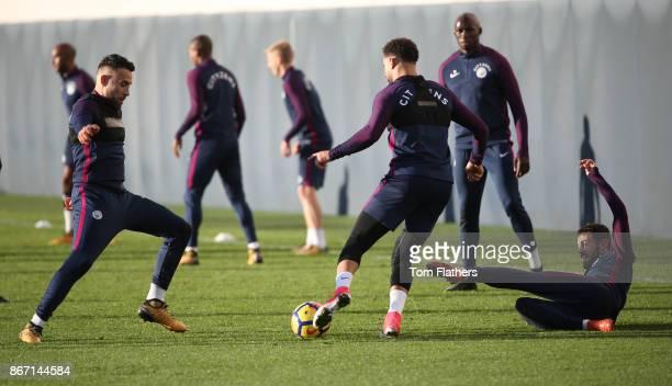 Manchester City's Nicholas Otamendi Kyle Walker and Bernado Silva during training at Manchester City Football Academy on October 27 2017 in...