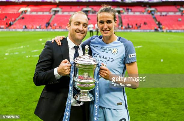 Manchester City's Nick Cushing and Jill Scott celebrate winning the FA Cup
