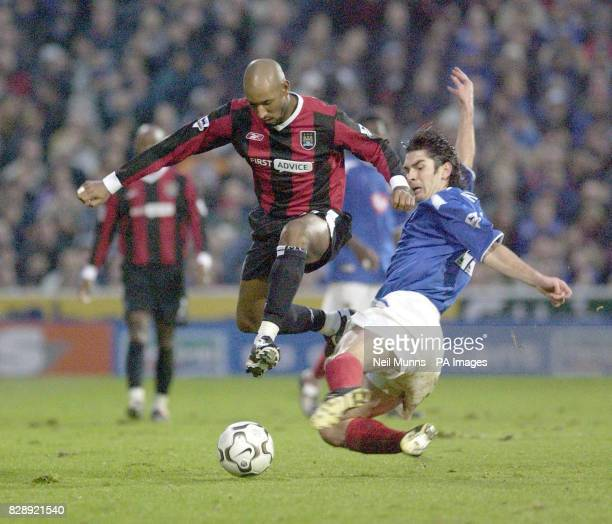Manchester City's Nicolas Anelka jumps Portsmouth's Dejan Stefanovic, during the Barclaycard Premiership match at Fratton Park, Portsmouth THIS...