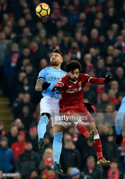 Manchester City's Nicolas Otamendi and Liverpool's Mohamed Salah battle for the ball during the Premier League match at Anfield Liverpool