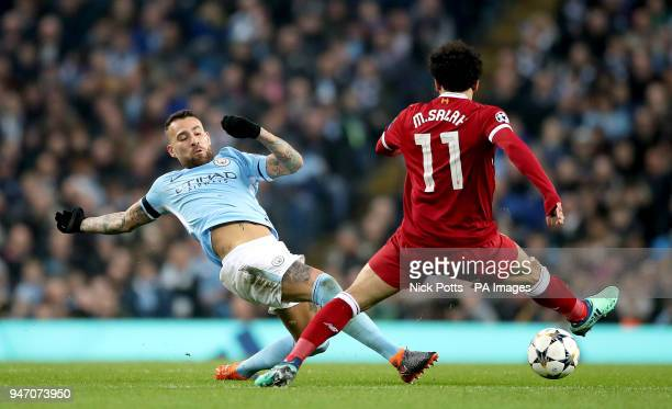 Manchester City's Nicolas Otamendi and Liverpool's Mohamed Salah battle for the ball