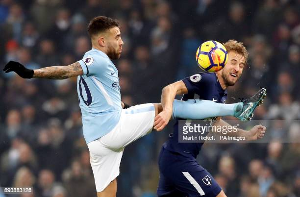 Manchester City's Nicolas Otamendi and Tottenham Hotspur's Harry Kane battle for the ball during the Premier League match at the Etihad Stadium...