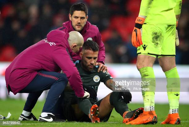 Manchester City's Nicolas Otamendi being treated