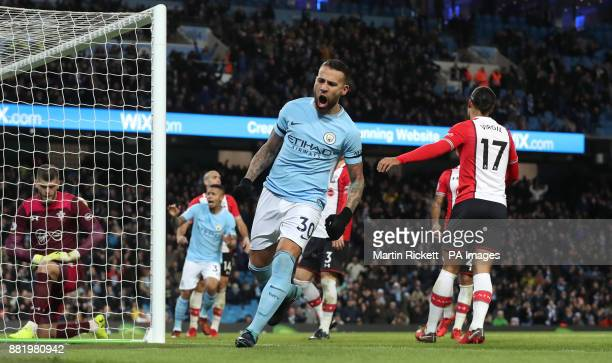 Manchester City's Nicolas Otamendi celebrates after teammate Kevin De Bruyne scores his side's first goal from a freekick during the Premier League...