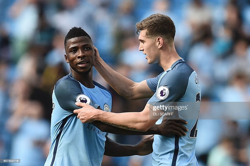 Manchester City's Nigerian striker Kelechi Iheanacho (L) and Manchester City's English defender John Stones (R) celebrate at the end of the English Premier League football match between Manchester City and Bournemouth at the Etihad Stadium in Manchester, north west England, on September 17, 2016. / AFP / OLI SCARFF / RESTRICTED TO EDITORIAL USE. No use with unauthorized audio, video, data, fixture lists, club/league logos or 'live' services. Online in-match use limited to 75 images, no video emulation. No use in betting, games or single club/league/player publications. /