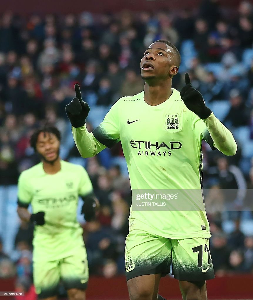 Manchester City's Nigerian striker Kelechi Iheanacho (R) celebrates scoring his team's third goal during the English FA Cup fourth round football match between Aston Villa and Manchester City at Villa Park in Birmingham, central England, on January 30, 2016. / AFP / JUSTIN TALLIS / RESTRICTED TO EDITORIAL USE. No use with unauthorized audio, video, data, fixture lists, club/league logos or 'live' services. Online in-match use limited to 75 images, no video emulation. No use in betting, games or single club/league/player publications. /