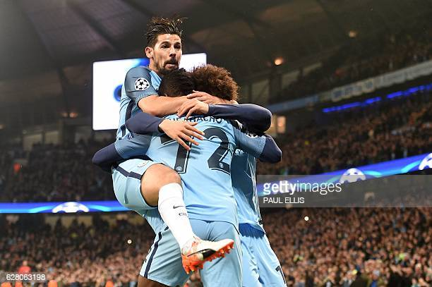 Manchester City's Nigerian striker Kelechi Iheanacho celebrates scoring his team's first goal with Manchester City's Spanish midfielder Nolito and...