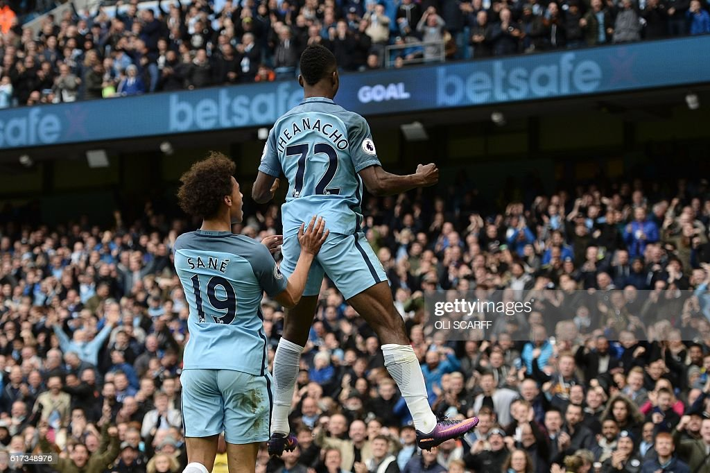 Manchester City's Nigerian striker Kelechi Iheanacho (R) celebrates with Manchester City's German midfielder Leroy Sane (L) after scoring their first goal during the English Premier League football match between Manchester City and Southampton at the Etihad Stadium in Manchester, north west England, on October 23, 2016. / AFP / Oli SCARFF / RESTRICTED TO EDITORIAL USE. No use with unauthorized audio, video, data, fixture lists, club/league logos or 'live' services. Online in-match use limited to 75 images, no video emulation. No use in betting, games or single club/league/player publications. /