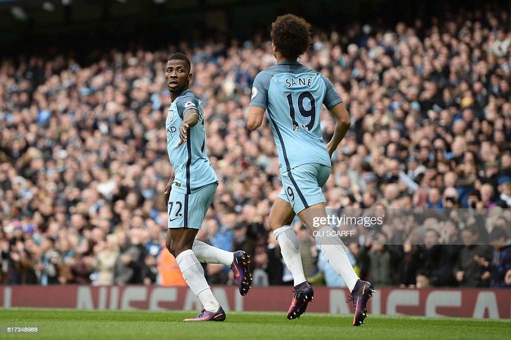 Manchester City's Nigerian striker Kelechi Iheanacho (L) celebrates with Manchester City's German midfielder Leroy Sane (R) after scoring their first goal during the English Premier League football match between Manchester City and Southampton at the Etihad Stadium in Manchester, north west England, on October 23, 2016. / AFP / Oli SCARFF / RESTRICTED TO EDITORIAL USE. No use with unauthorized audio, video, data, fixture lists, club/league logos or 'live' services. Online in-match use limited to 75 images, no video emulation. No use in betting, games or single club/league/player publications. /