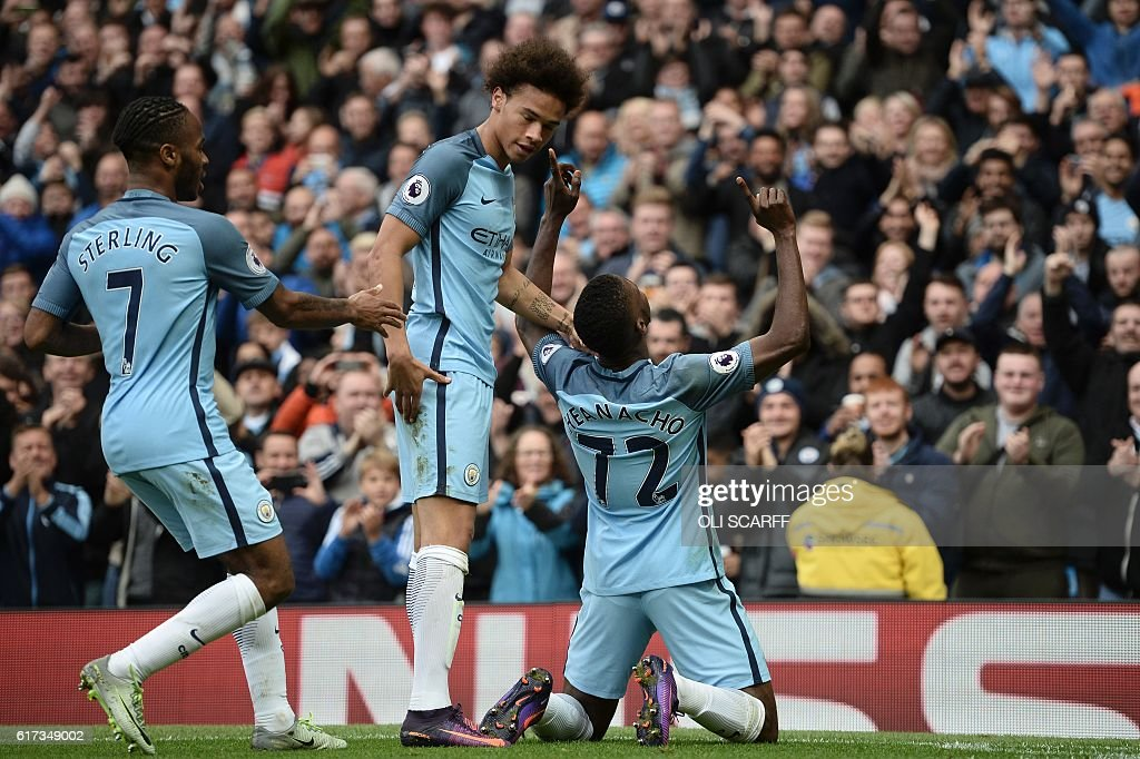Manchester City's Nigerian striker Kelechi Iheanacho (R) celebrates with Manchester City's German midfielder Leroy Sane (C) and Manchester City's English midfielder Raheem Sterling (L) after scoring their first goal during the English Premier League football match between Manchester City and Southampton at the Etihad Stadium in Manchester, north west England, on October 23, 2016. / AFP / Oli SCARFF / RESTRICTED TO EDITORIAL USE. No use with unauthorized audio, video, data, fixture lists, club/league logos or 'live' services. Online in-match use limited to 75 images, no video emulation. No use in betting, games or single club/league/player publications. /