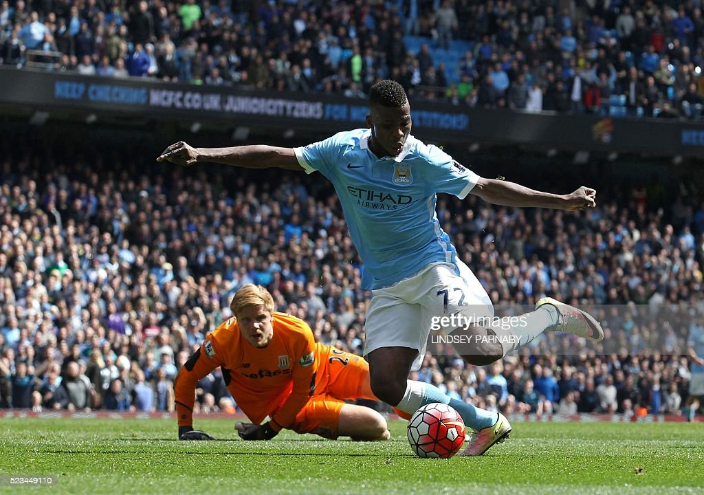 Manchester City's Nigerian striker Kelechi Iheanacho goes around Stoke City's Danish goalkeeper Jakob Haugaard (L) to score their fourth goal during the English Premier League football match between Manchester City and Stoke City at the Etihad Stadium in Manchester, north west England, on April 23, 2016. / AFP / LINDSEY PARNABY / RESTRICTED TO EDITORIAL USE. No use with unauthorized audio, video, data, fixture lists, club/league logos or 'live' services. Online in-match use limited to 75 images, no video emulation. No use in betting, games or single club/league/player publications. /