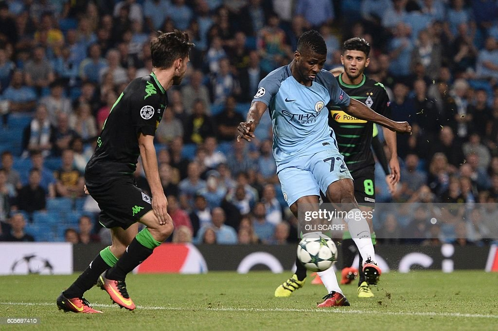 Manchester City's Nigerian striker Kelechi Iheanacho (2R) scores their fourth goal during the UEFA Champions League group C football match between Manchester City and Borussia Monchengladbach at the Etihad stadium in Manchester, northwest England, on September 14, 2016. / AFP / OLI