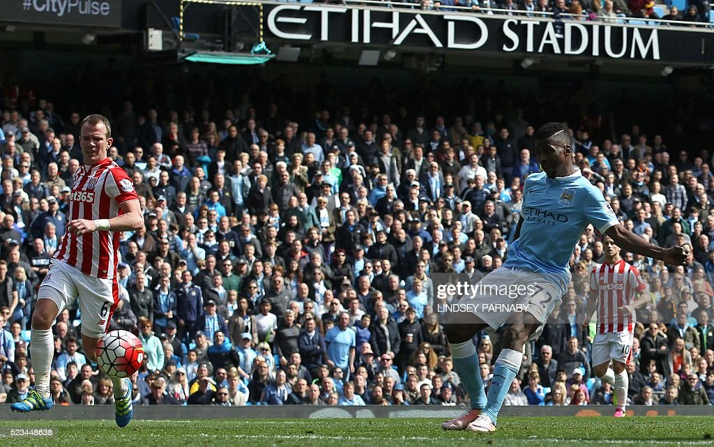 Manchester City's Nigerian striker Kelechi Iheanacho (R) shoots to score their third goal during the English Premier League football match between Manchester City and Stoke City at the Etihad Stadium in Manchester, north west England, on April 23, 2016. / AFP / LINDSEY PARNABY / RESTRICTED TO EDITORIAL USE. No use with unauthorized audio, video, data, fixture lists, club/league logos or 'live' services. Online in-match use limited to 75 images, no video emulation. No use in betting, games or single club/league/player publications. /