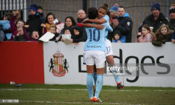 Manchester City's Nikita Parris celebrates with Nadia Nadim after scoring to make it 03 the WSL match between Sunderland AFC Ladies and Manchester...