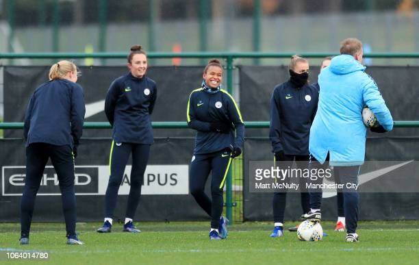 Manchester City's Nikita Parris shares a joke with teammates during the training session at Manchester City Football Academy on November 20 2018 in...