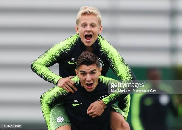 Manchester City's Oleksandr Zinchenko and Brahim Diaz during training at Manchester City Football Academy on August 3 2018 in Manchester England