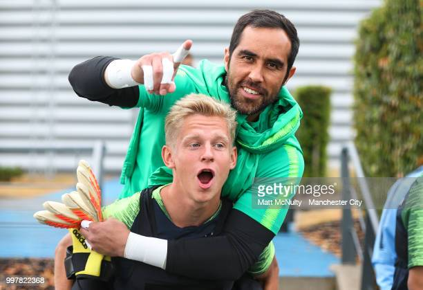 Manchester City's Oleksandr Zinchenko and Claudio Bravo during training at Manchester City Football Academy on July 13 2018 in Manchester England