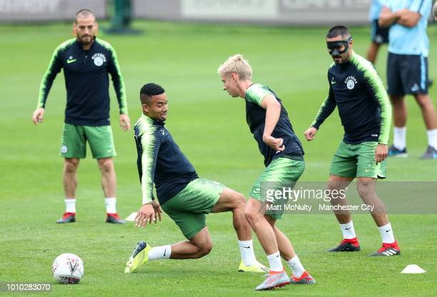 Manchester City's Oleksandr Zinchenko and Gabriel Jesus during training at Manchester City Football Academy on August 3 2018 in Manchester England