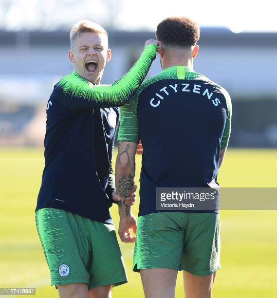 Manchester City's Oleksandr Zinchenko and Kyle Walker react during training at Manchester City Football Academy on February 25 2019 in Manchester...