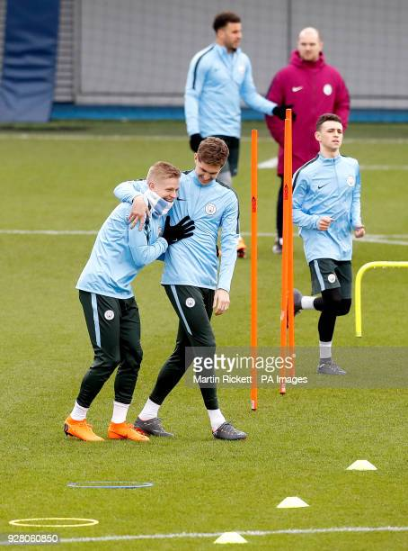 Manchester City's Oleksandr Zinchenko and Manchester City's John Stones during the training session at the CFA Manchester