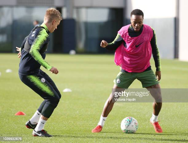 Manchester City's Oleksandr Zinchenko and Raheem Sterling in action at Manchester City Football Academy on September 24 2018 in Manchester England