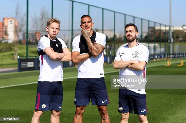 Manchester City's Oleksandr Zinchenko Danilo and Bernardo Silva pose during the training session at Manchester City Football Academy on April 19 2018...