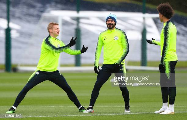 Manchester City's Oleksandr Zinchenko Ilkay Gundogan and Leroy Sane warm up during the training session at Manchester City Football Academy on May 09...