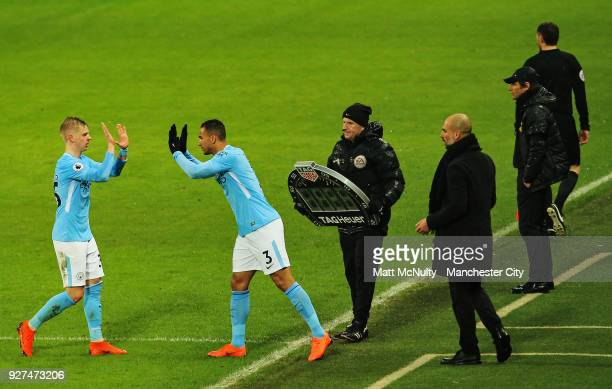 Manchester City's Oleksandr Zinchenko is replaced by Danilo during the Premier League match between Manchester City and Chelsea at Etihad Stadium on...