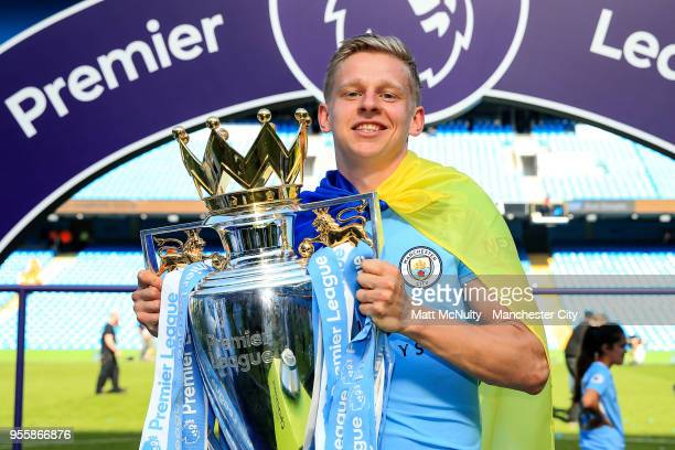 Manchester City's Oleksandr Zinchenko poses with the Premier League trophy after the Premier League match between Manchester City and Huddersfield...