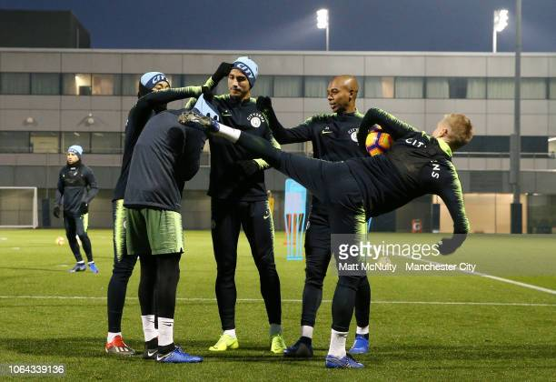 Manchester City's Oleksandr Zinchenko shares a joke with teammates during a training session at Manchester City Football Academy on November 22 2018...