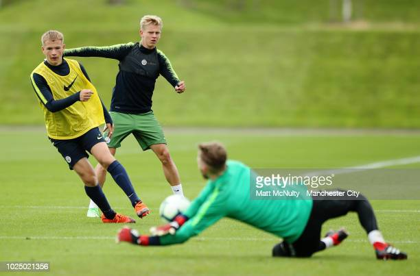 Manchester City's Oleksandr Zinchenko watches his shot saved by Daniel Grimshaw during training at Manchester City Football Academy on August 29 2018...