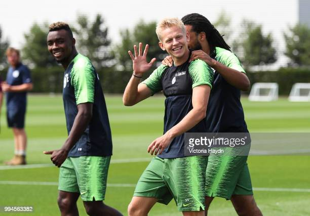 Manchester City's Oleksandr Zinchenko waves during training at Manchester City Football Academy on July 6 2018 in Manchester England