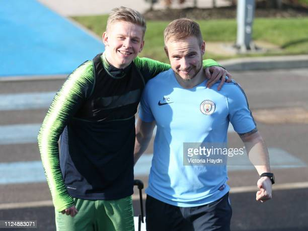 Manchester City's Olkesandr Zinchenko and kitman Michael Clitheroe react at Manchester City Football Academy on February 14 2019 in Manchester England