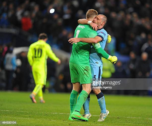 Manchester City's Pablo Zabaleta hugs goalkeeper Joe Hart after he saved the penalty from Barcelona's Lionel Messi during the UEFA Champions League...