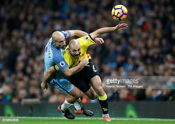 Manchester City's Pablo Zabaleta pulls back on Watford's Nordin Amrabat during the Premier League match at the Etihad Stadium Manchester