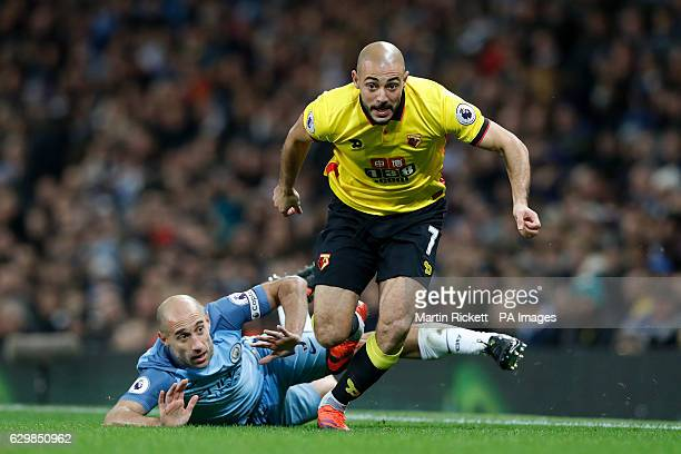 Manchester City's Pablo Zabaleta pulls back on Watford's Nordin Amrabat during the Premier League match at the Etihad Stadium Manchester