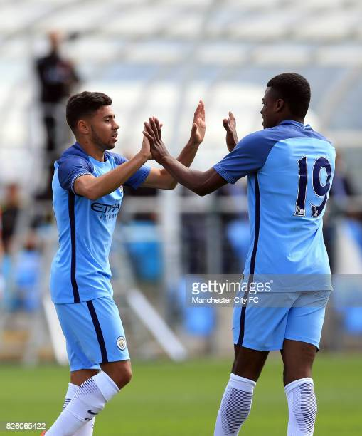 Manchester City's Paolo Fernandes celebrates with teammate Javairo Dilrosun after he scores his sides second goal