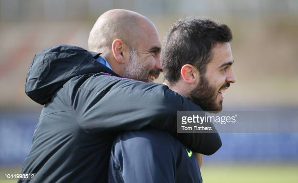 Manchester City's Pep Guardiola and Bernardo Silva in action during training at the SportparkArena Pronto on October 3 2018 in Bad Schonborn Germany