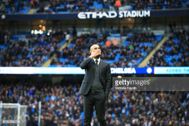 Manchester City's Pep Guardiola blows a kiss to family in the stadium