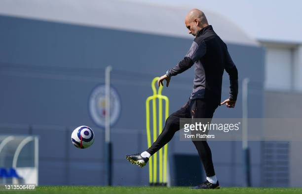 Manchester City's Pep Guardiola in action during training at Manchester City Football Academy on April 20, 2021 in Manchester, England.