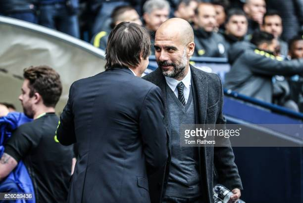 Manchester City's Pep Guardiola shakes hands with Chelsea's Antonio Conte