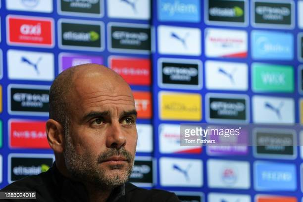 Manchester City's Pep Guardiola speaks during a press conference at Manchester City Football Academy on October 30, 2020 in Manchester, England.