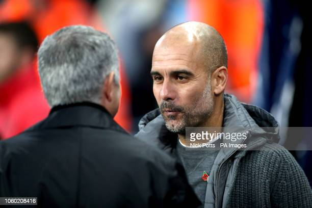 Manchester City's Pep Guardiola with Manchester United's Jose Mourinho during the Premier League match at the Etihad Stadium, Manchester.