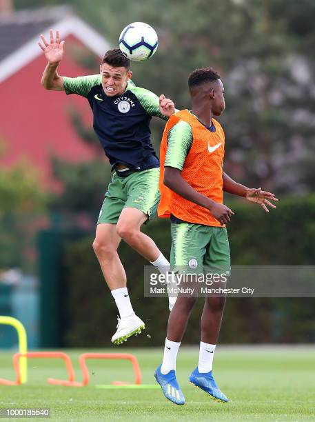 Manchester City's Phil Foden and Rabbi Matondo during training at Manchester City Football Academy on July 16 2018 in Manchester England