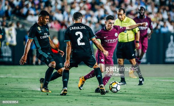 Manchester City's Phil Foden and Real Madrid's Casemiro and Dani Carvajal in action at the Los Angeles Memorial Coliseum on July 26 2017 in Los...