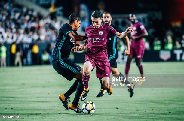 Manchester City's Phil Foden and Real Madrid's Raphael Varane in action at the Los Angeles Memorial Coliseum on July 26 2017 in Los Angeles California