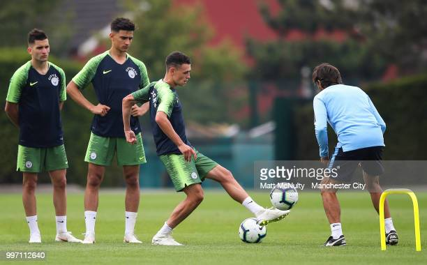 Manchester City's Phil Foden and teammates during training at Manchester City Football Academy on July 12 2018 in Manchester England