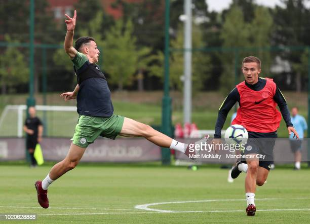 Manchester City's Phil Foden and Tyreke Wilson during training at Manchester City Football Academy on August 20 2018 in Manchester England