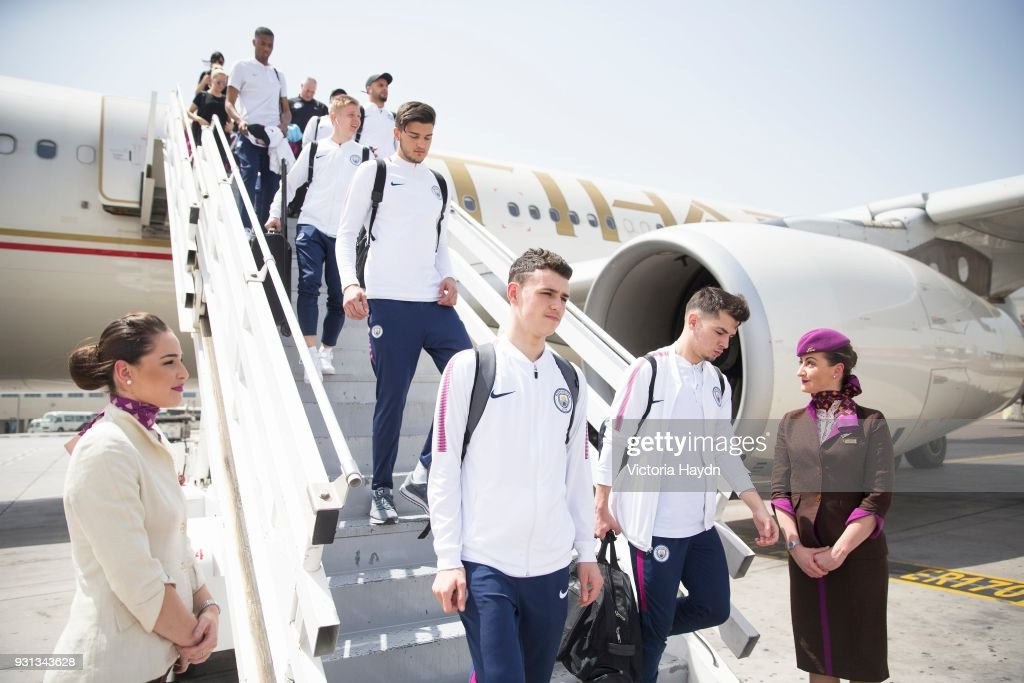 Manchester City's Phil Foden, Brahim Diaz and teammates arrive at Abu Dhabi International Airport on March 13, 2018 in Abu Dhabi, UAE.