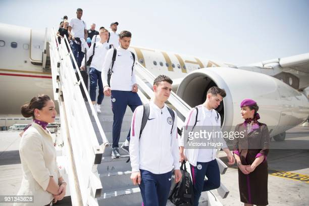Manchester City's Phil Foden Brahim Diaz and teammates arrive at Abu Dhabi International Airport on March 13 2018 in Abu Dhabi UAE